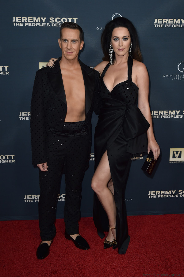 "Jeremy Scott, left, and Katy Perry pose during her handprint ceremony after the premiere of ""Jeremy Scott: The People's Designer"" at the TCL Chinese Theatre on Tuesday, Sept. 8, 2015, in Hollywood, Calif. (Photo by Jordan Strauss/Invision/AP)"